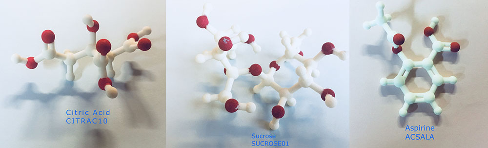 Photo of 3D printed models of molecules of citric acid, sucrose and aspirin